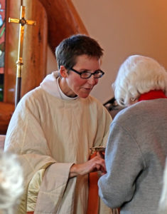 All Saints in Big Sky Giving Communion